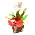 Vase doré avec orchidé